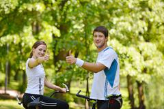 Stock Photo of happy couple riding bicycle outdoors