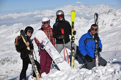Stock Photo of people group on snow at winter season