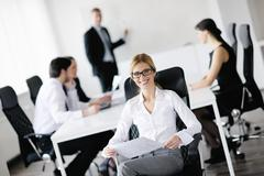 business woman with her staff in background - stock photo