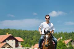 Man ride horse Stock Photos