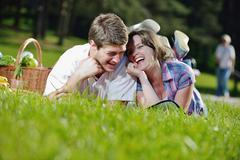 Happy young couple having a picnic outdoor Stock Photos