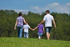 Happy young family have fun outdoors Stock Photos