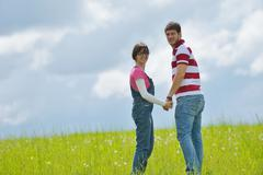 Stock Photo of portrait of romantic young couple smiling together outdoor