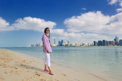 Stock Photo of happy tourist woman