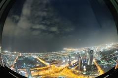 panorama of down town dubai city at night - stock photo