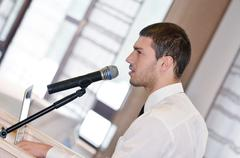 Stock Photo of young  business man giving a presentation on conference