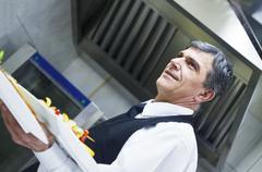 male chef presenting food - stock photo