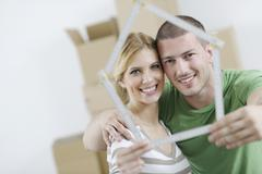 young couple moving in new home - stock photo