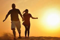 Stock Photo of couple enjoying the sunset