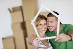 Stock Photo of young couple moving in new house