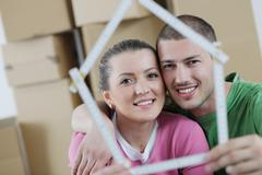 young couple moving in new house - stock photo
