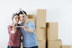 Young couple moving in new house Stock Photos
