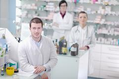 Pharmacy drugstore people team Stock Photos
