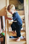 Stock Photo of beautiful young child making first steps
