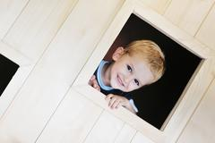 Stock Photo of happy child in a window