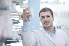 Pharmacist chemist man in pharmacy drugstore Stock Photos