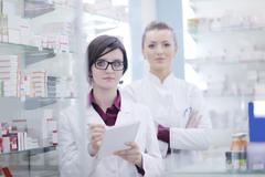 Stock Photo of team of pharmacist chemist woman  in pharmacy drugstore