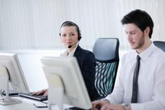 Stock Photo of business people group working in customer and helpdesk office