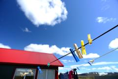 Artistic picture of clothes peg hanging in the sun Stock Photos