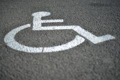 Signage for handicap on the road Stock Photos