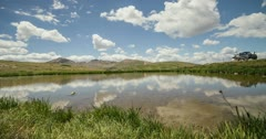 2K 30p Pond at the top of the Continental Divide reflects the sky timelapse Stock Footage