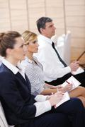 business people group on seminar - stock photo