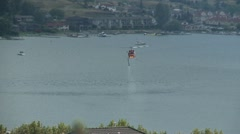 Helicopter, Huey inbound from lake, follow shot Stock Footage