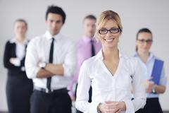 Stock Photo of business woman standing with her staff in background