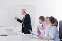 senior business man giving a presentation - stock photo