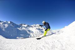 Stock Photo of skiing on fresh snow at winter season at beautiful sunny day