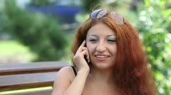 Girl talking on a cell phone. Stock Footage