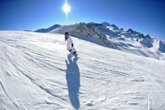 Stock Photo of skiing on fresh snow at winter season at beautiful sunny day