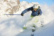 Skiing on fresh snow at winter season at beautiful sunny day Stock Photos