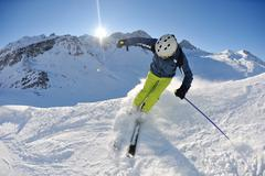 skiing on fresh snow at winter season at beautiful sunny day - stock photo