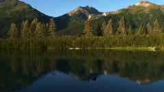 Mountains Reflected in Rippling Peaceful Lake Waters Stock Footage