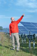 male solar panel engineer at work place - stock photo