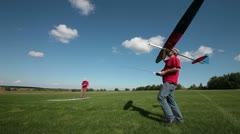 Man launches into the sky RC glider, assembly series launches Stock Footage