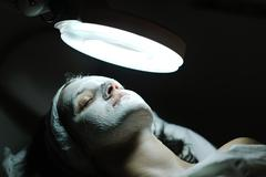 Stock Photo of woman with facial mask in cosmetic studio
