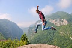 man jump in nature - stock photo