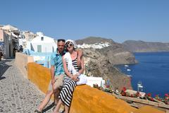 Happy young couple tourists in greece Stock Photos