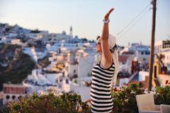 Stock Photo of greek woman on the streets of oia, santorini, greece