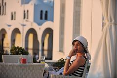 greek woman on the streets of oia, santorini, greece - stock photo
