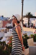 Stock Photo of greek woman on the streets of oia, santorini, greece