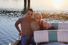 Stock Photo of couple in love  have romantic time on boat