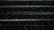 Tv snow noise on black screen Stock Footage