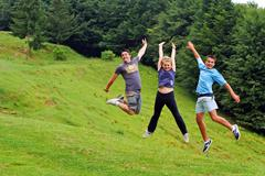happy youngsters jumping - stock photo
