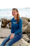 young girl at seaside - stock photo