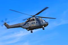 Stock Photo of Helicopter against blue sky