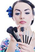 Stock Photo of beautiful young woman applying makeup