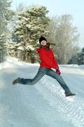 Young woman jumping, winter scene - stock photo